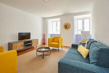 Comfortable living room with sofa bed and two additional bedrooms, twin and double.